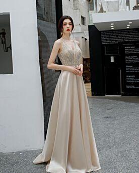 Vestiti Da Sera Da Cerimonia Impero Con Schiena Scoperta Lunghi Scollo Profondo 2020 Eleganti Abiti 18 Anni Da Ballo Senza Maniche Con Perline
