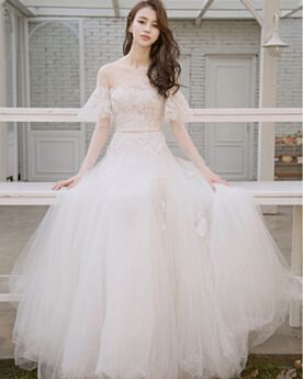 See Through Appliques Charming Open Back Wedding Dresses Tulle A Line Outdoor Off The Shoulder Half Sleeve