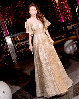 Vestidos De Nochevieja Dorados De Tul Vestidos De Fiesta De Noche Lentejuelas 2019 Vestidos Para Prom A Mangas Acampanadas Brillantes Transparentes Escote V Pronunciado