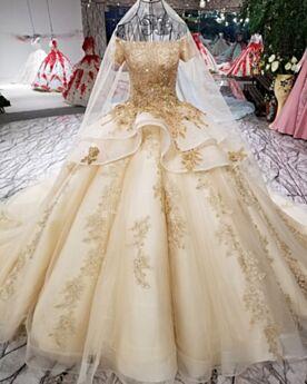 Robe De Mariée Dentelle Avec La Queue Peplum Appliques Luxe Boule Dorée Longue Glitter Epaule Dénudée Brillante