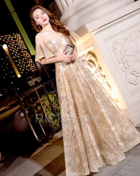 Robe Gala De Bal Décolleté Dos Nu Transparente Empire Dorée Robe De Réveillon Longue Sequin Demi Manche Brillante Sexy
